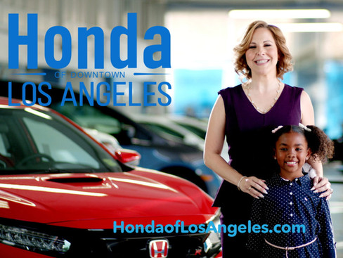 Honda with a woman and a little girl