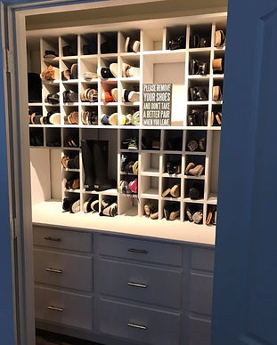 Custom shoe closet with 97 shoe cubbies