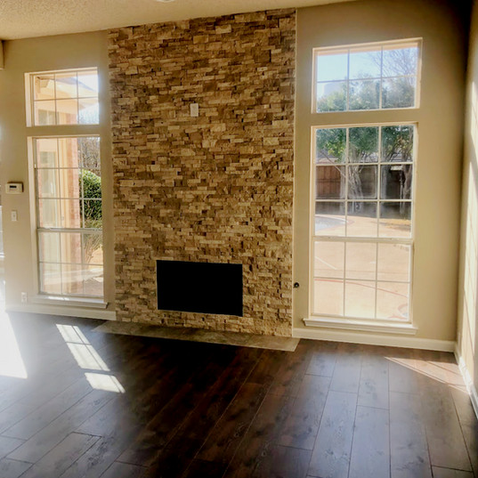 Floor to ceiling stacked stone no mantel