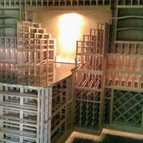 Island storage shaped like a wine bottle