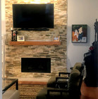 Stacked stone with rustic mantel