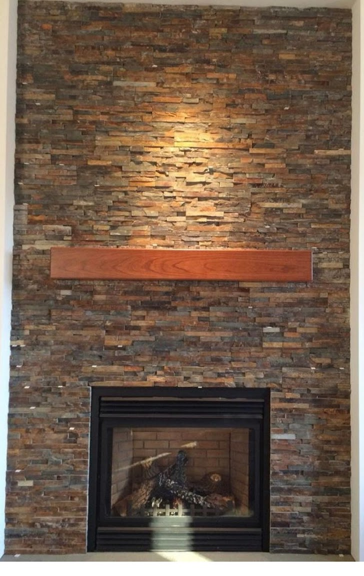 Floor to ceiling mixed stacked stone