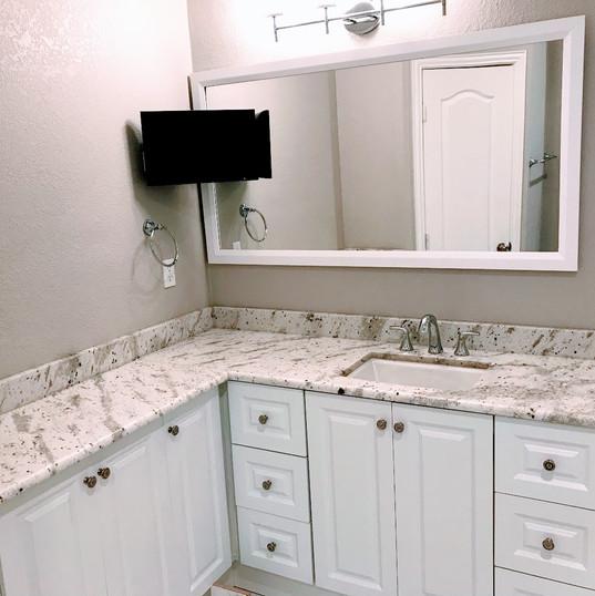 Custom corner vanity for added counter s