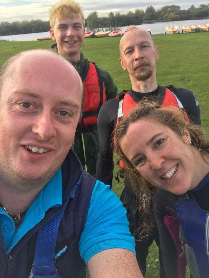 a selfie of staff members in life jackets