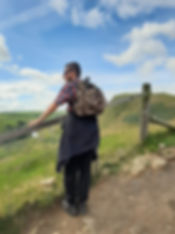 A service user looking past a fence out to the views in the Peak District