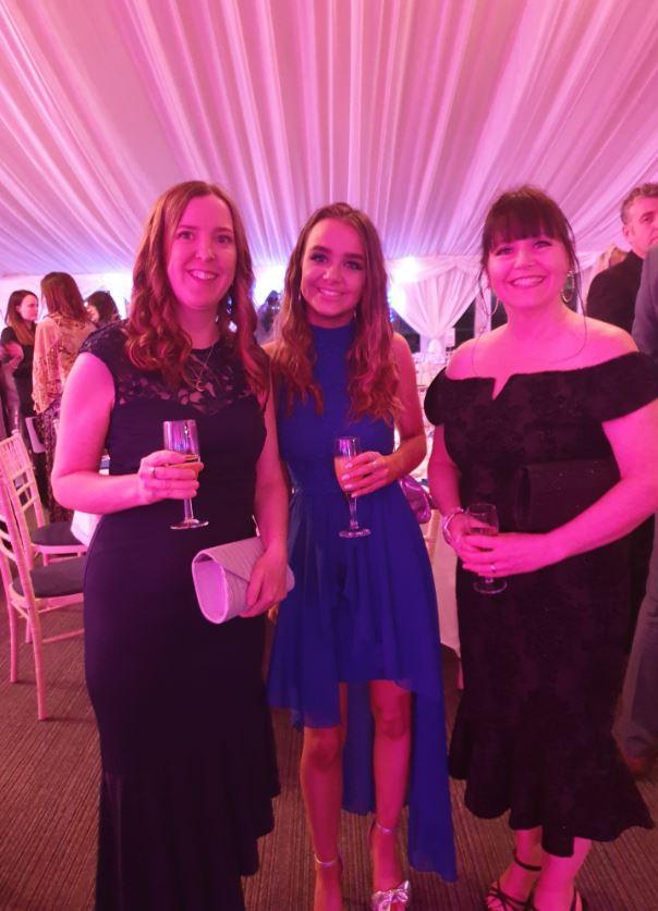 Three ladies in a posh dresses.
