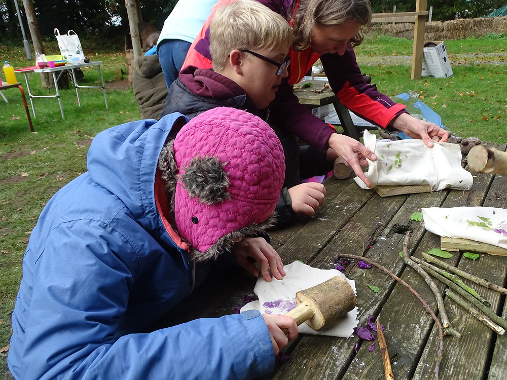 Two students doing some natural crafts.