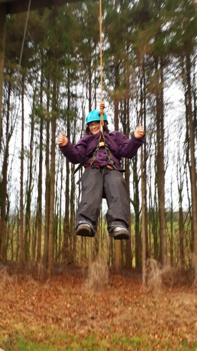 A young lady on high ropes