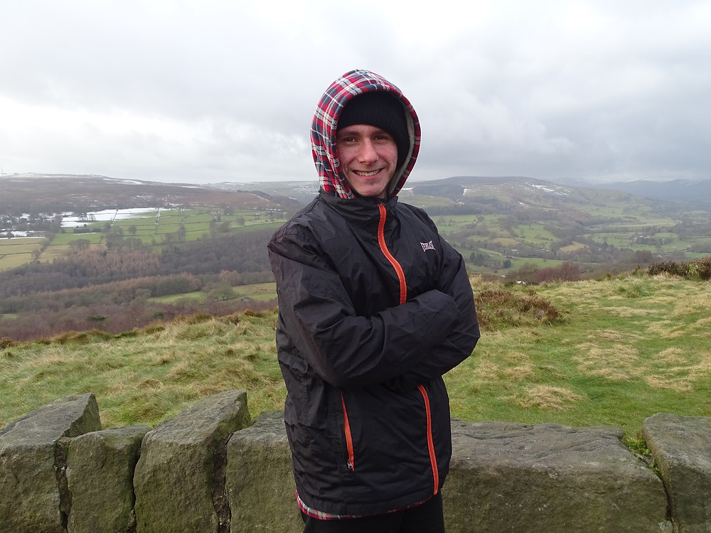 Service User posing for a photo on a walk in the peaks.