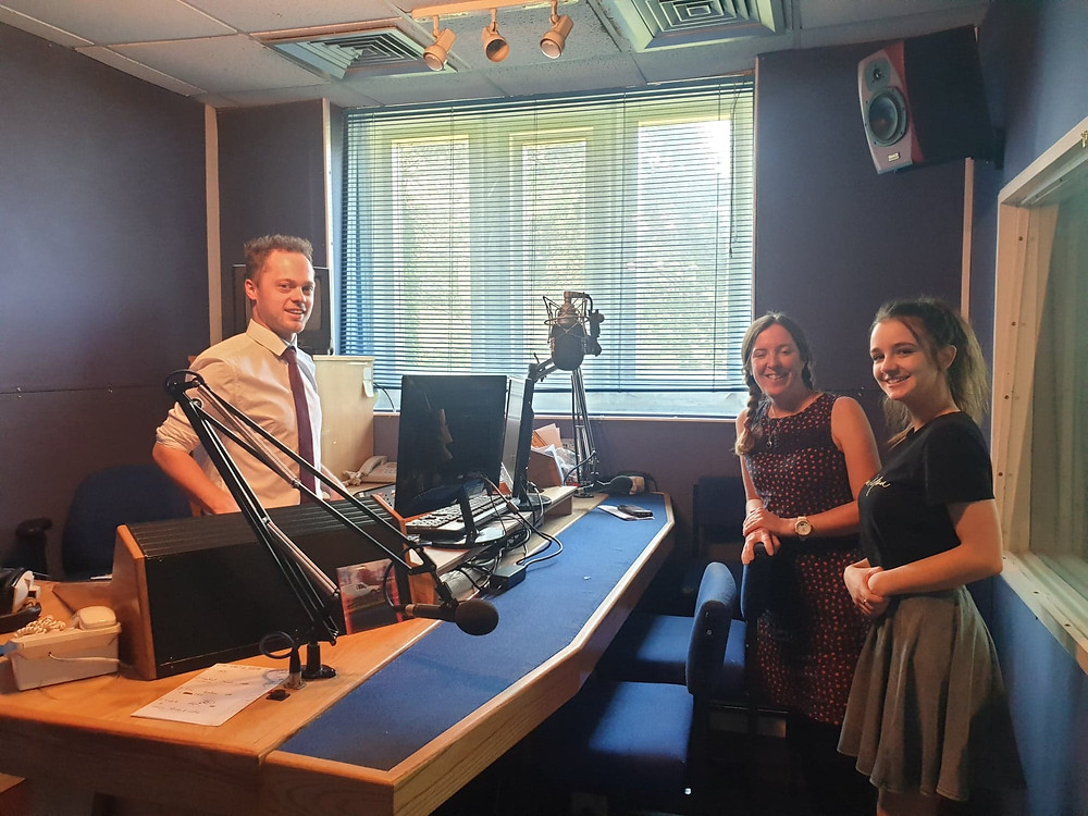 Producer and two TAS staff members in a radio recording studio.