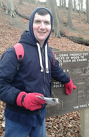 A client pointing at an information board at Sherwood Pines