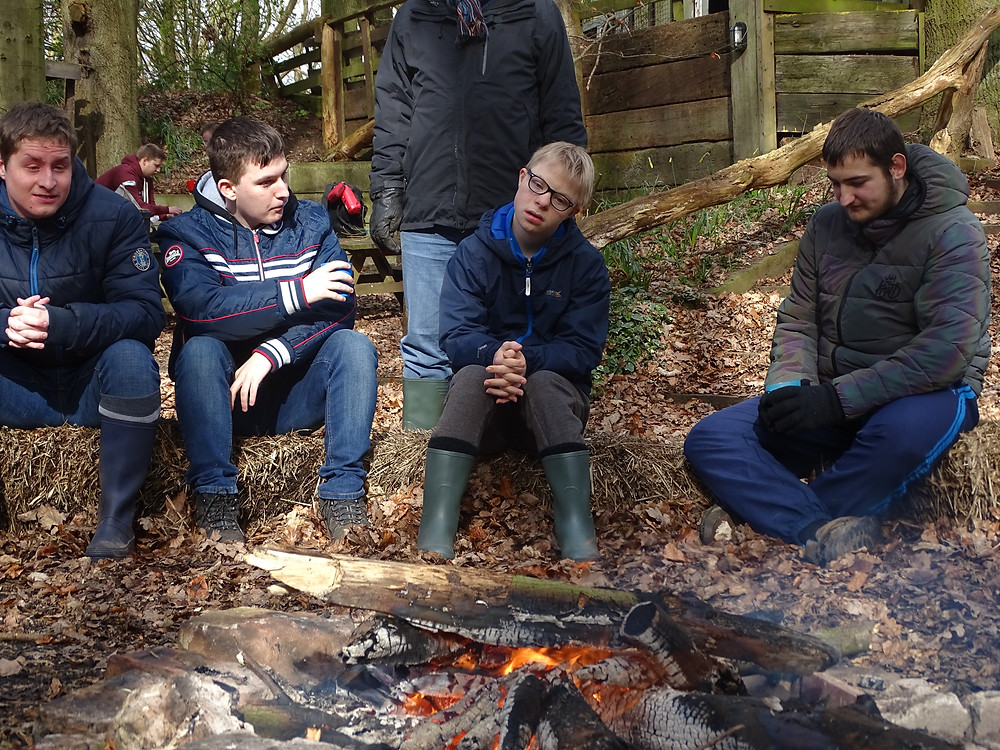 The Newark Orchard students sat around the campfire at Blakeley Lane Campsite.