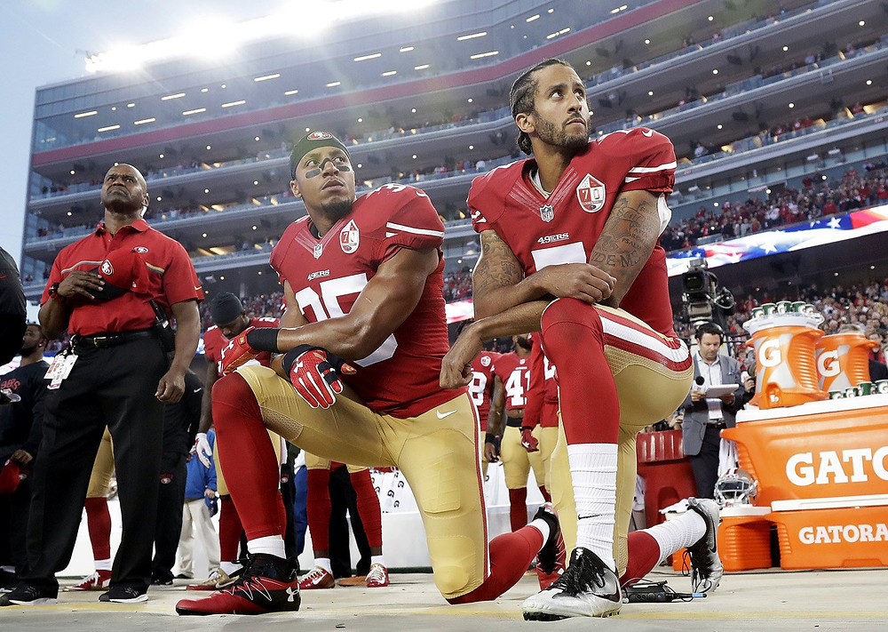 Colin Kaepernick kneeling during national anthem
