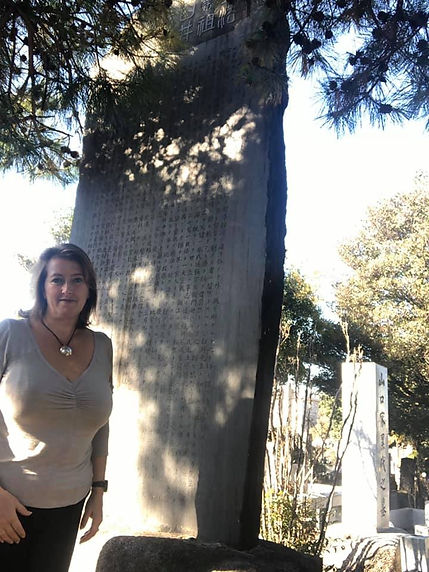 Jacquie at Usuis memorial stone.jpg