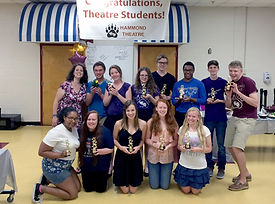 theatre students holding awards