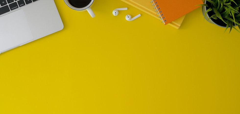 top-view-photo-of-earpods-near-coffee-cu