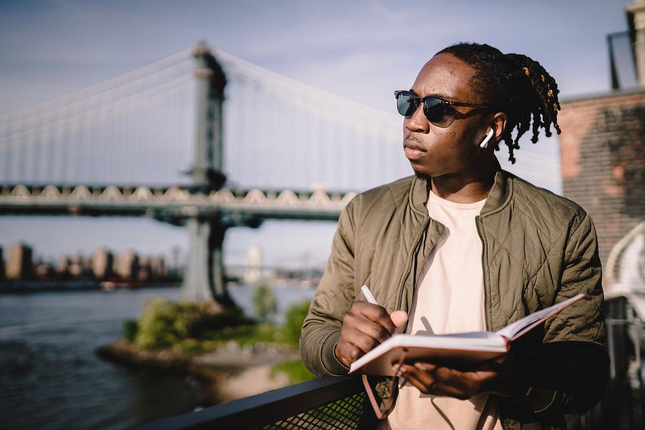 contemplative-black-man-in-wireless-earp