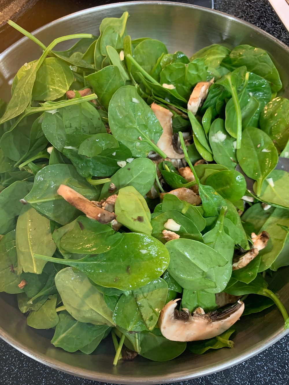 Spinach, mushrooms and garlic before cooking