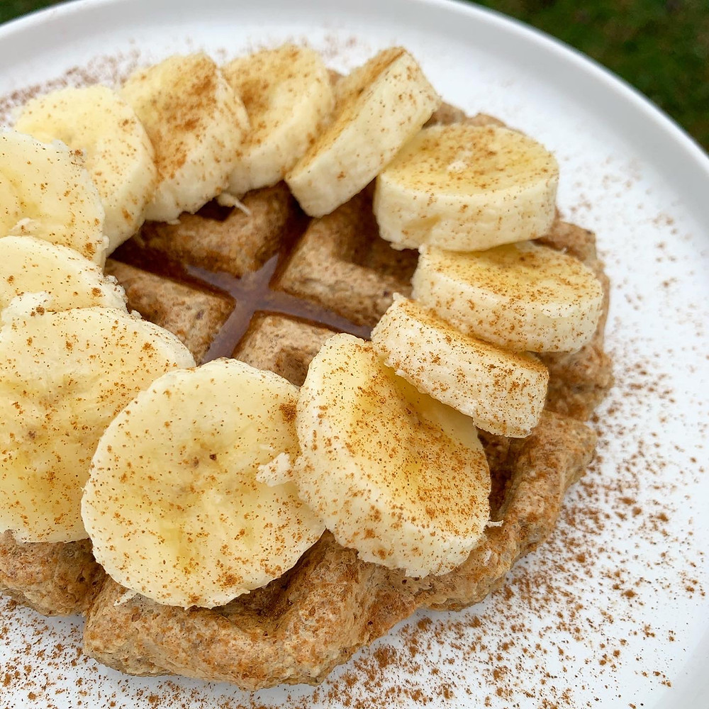 Banana Oat Waffles topped with fresh banana slices and cinnamon