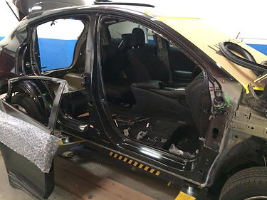 car after a collision in auto body shop