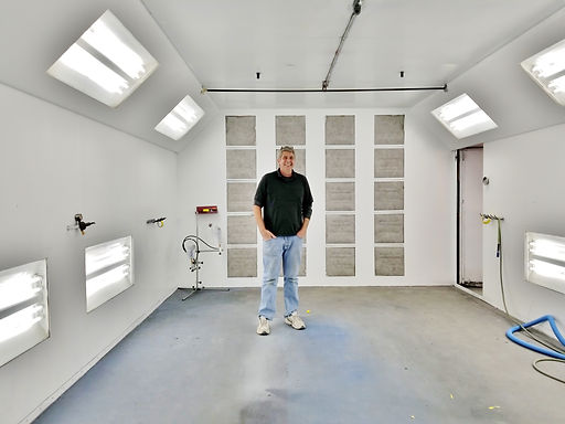 Dave in his paint room at the auto body shop
