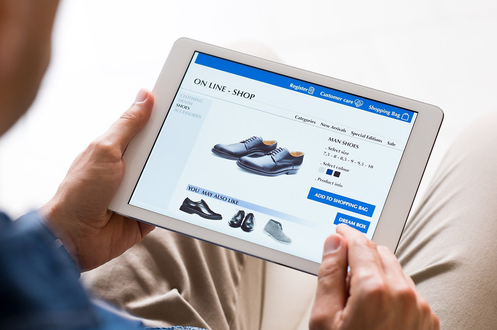 zoomed-in-image-young-man-looking-at-dress-shoes-in-online-shop