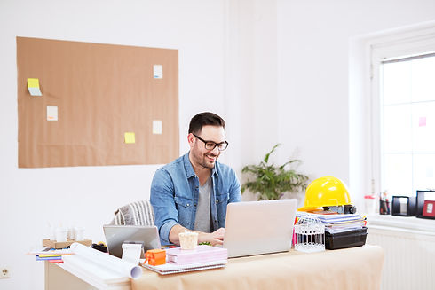 happy-smiling-young-handsome-modern-professional-working-laptop-his-large-modern-office