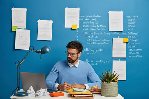 young-content-writing-professional-reasearching-content-topics-and-keywords-in-trendy-office