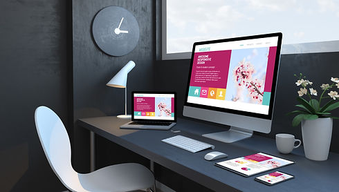 office-with-multiple-devices-displaying-responsive-website