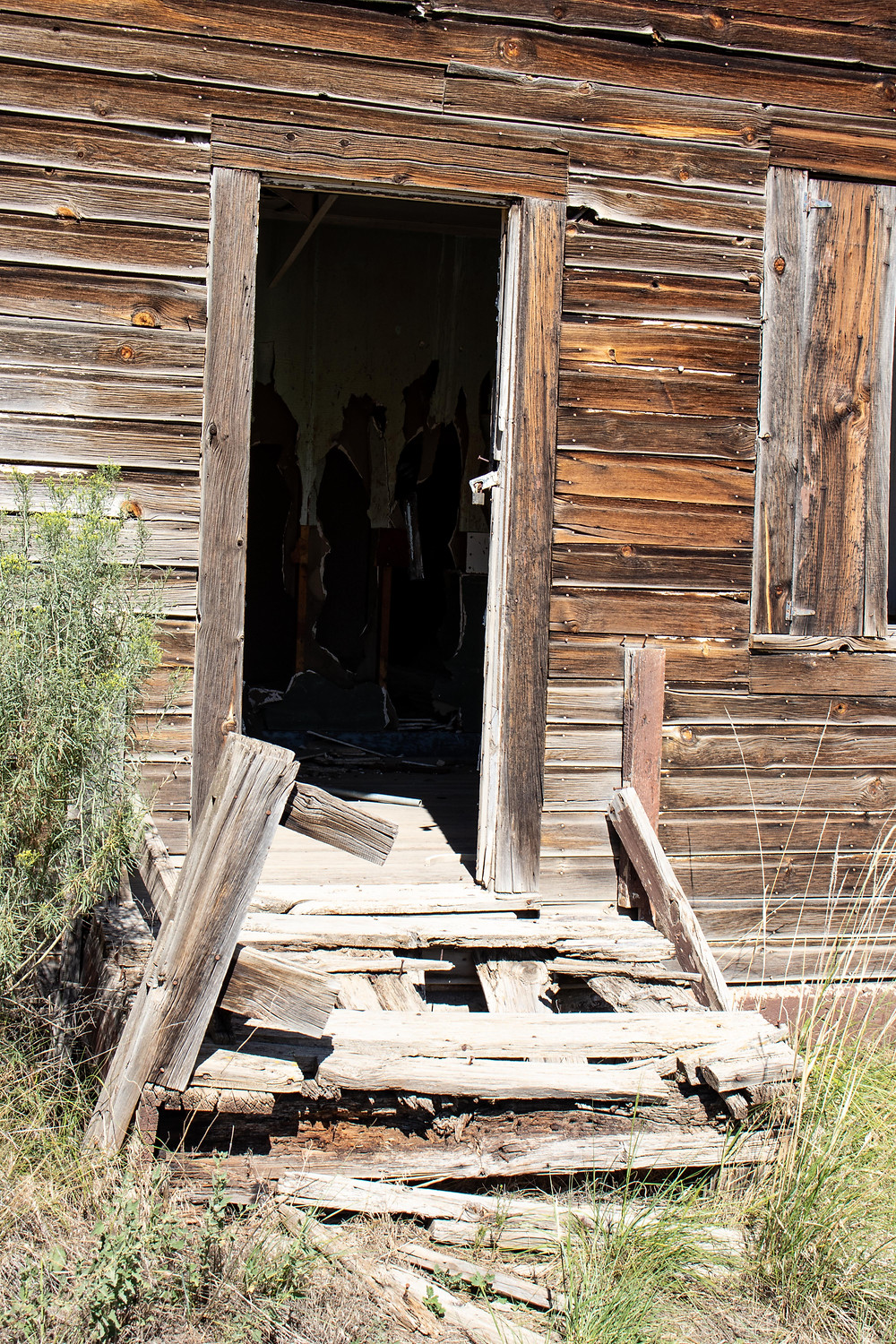 Crumbling stairs in Pagosa Junction ghost town building.