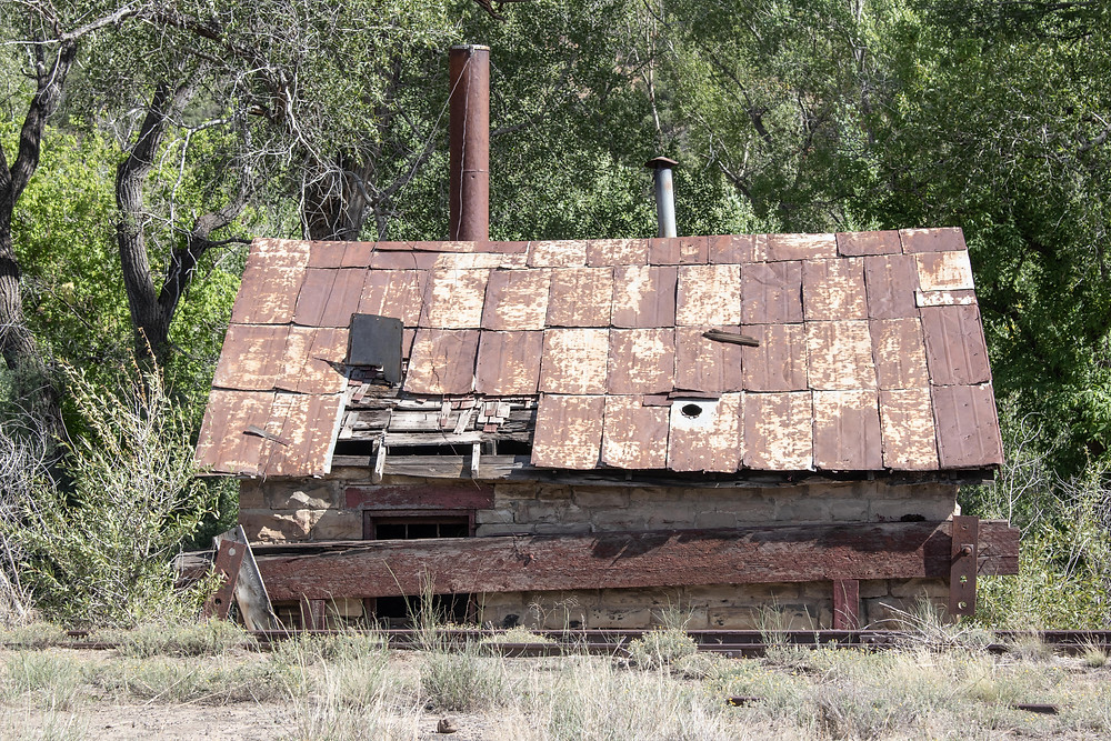 Rusted, dilapidated train building in Pagosa Junction