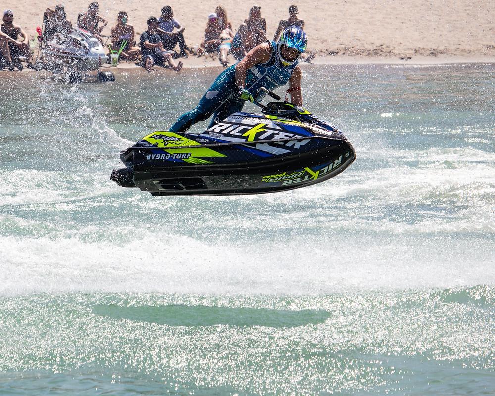 Jet ski rider Mark Gomez flies over water.