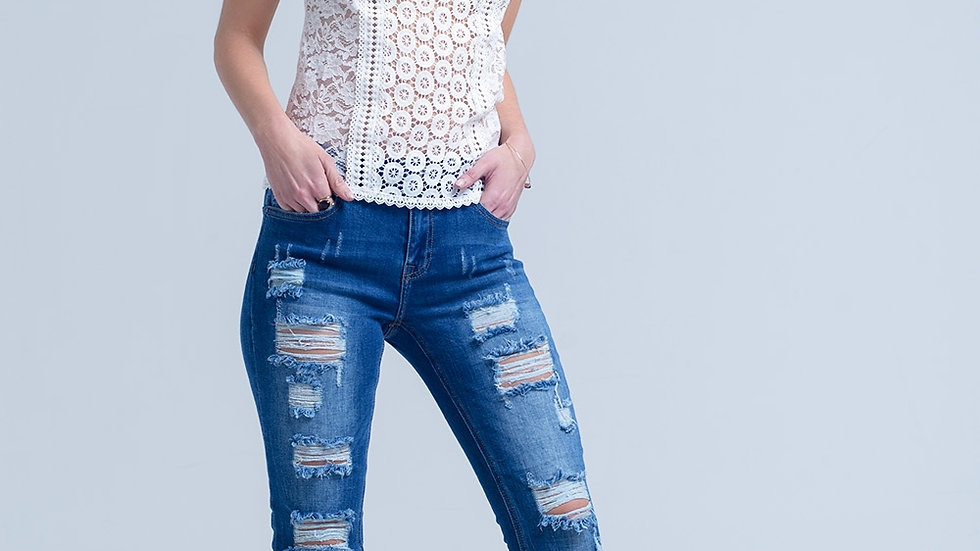 Jeans With Shredded Rips and Raw-Cut Cuffs