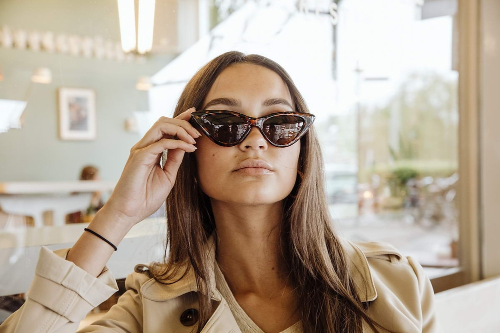 street style in coffee shop featuring sunglasses
