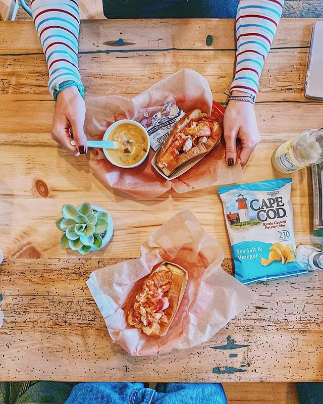 Lobster rolls shared with friends in Boston, cape cod chips