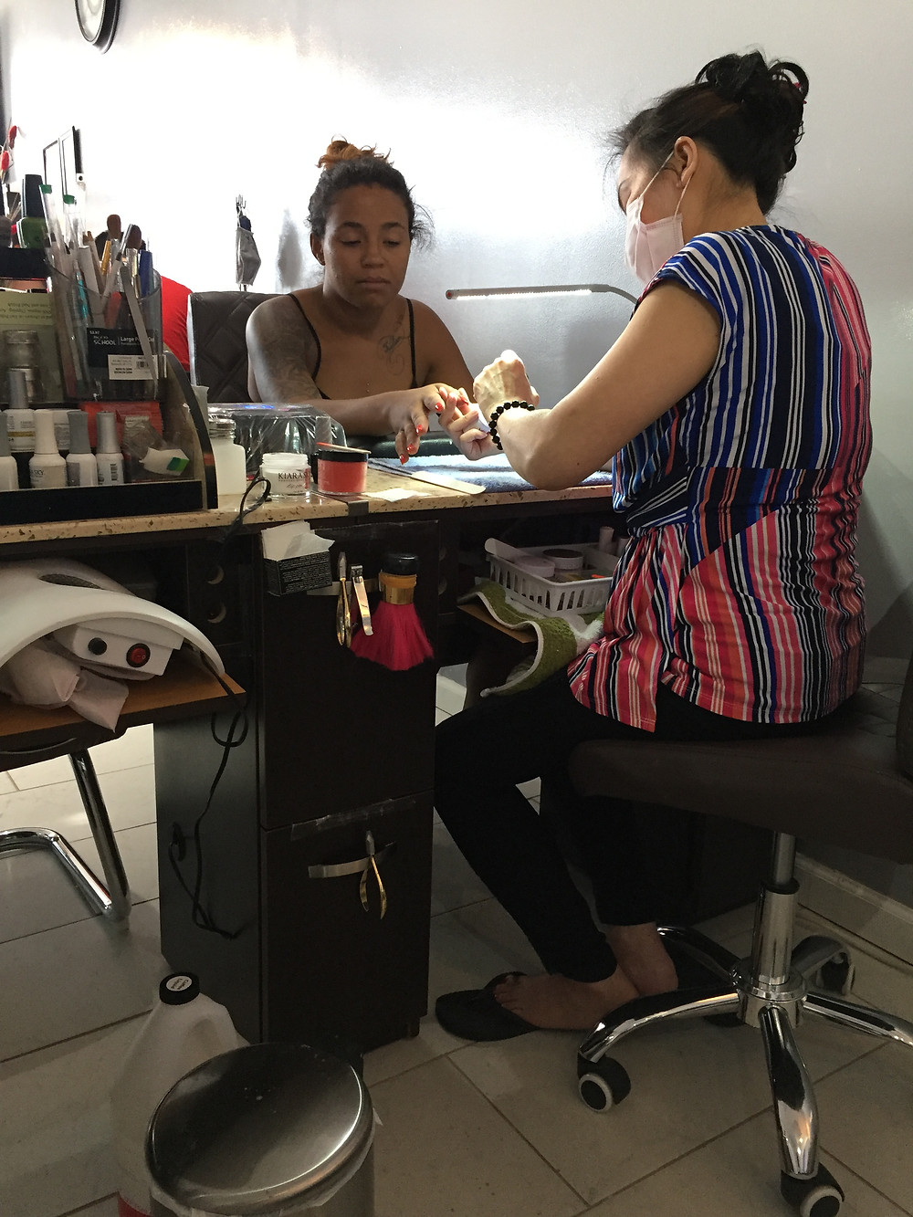 My aunt in her nail salon and her customer, international students in us blog, alien thoughts