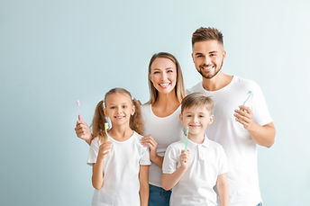 Family with toothbrushes.jpg