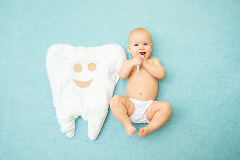 Baby next to tooth.jpg