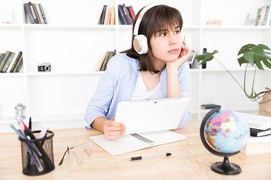 pensive-female-student-listening-music_2