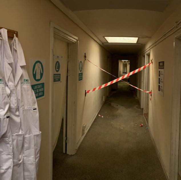 Lab Coats and Warning Sign