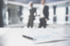 Documents and Blurred Business Men_edited.jpg