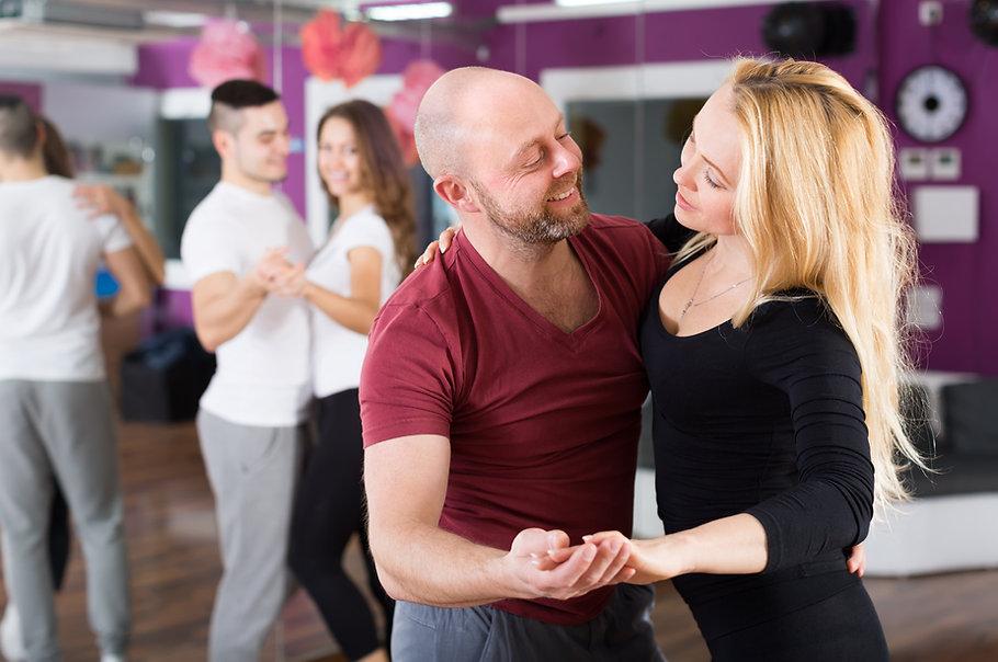 Group of joyful happy young adults dancing at dance class.jpg