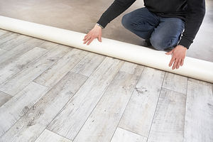 Rolling out a PVC Fake Wood Flooring.jpg