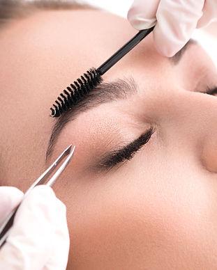 A girl having a brow treatment