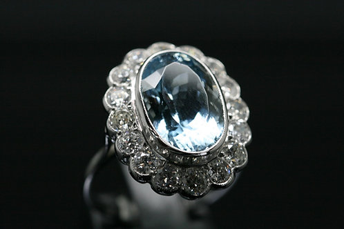 18ct White Gold Diamond And Aquamarine Halo Ring