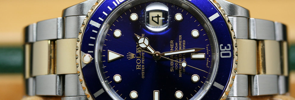 Pre-Owned Rolex 2003 Blue Submariner with papers