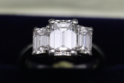 Emerald Cut Diamond and Platinum Three Stone