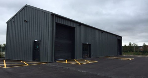 Steeel clad building, portal frame building, industrial building, warehouse building, workshop building, truck, lorry repair bay