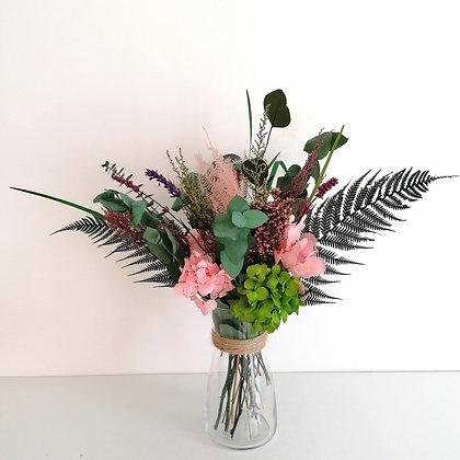Botanical arrangement with vase
