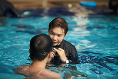 Patient Swimming Coach